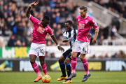 Vurnon Anita (C) of Newcastle United competes against Max Gradel (L) and Dan Gosling (R) of Bournemouth  during the Barclays Premier League match between Newcastle United and A.F.C. Bournemouth at St James' Park on March 5, 2016 in Newcastle upon Tyne, England.