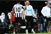 Hatem Ben Arfa (L) of Newcastle United celebrates victory with Newcastle United coach Steve Stone after the Barclays Premier League match between Newcastle United and Fulham at St James' Park on August 31, 2013 in Newcastle upon Tyne, England.