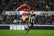 Nicklas Bendtner (l) challenges Ciaran Clark  during the Sky Bet Championship match between Newcastle United and Nottingham Forest at St James' Park on December 30, 2016 in Newcastle upon Tyne, England.