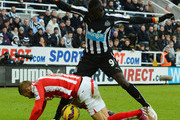 Phil Bardsley of Stoke City is challenged by Papiss Cisse of Newcastle United during the Barclays Premier League match between Newcastle United and Stoke City at St James' Park on February 8, 2015 in Newcastle upon Tyne, England.