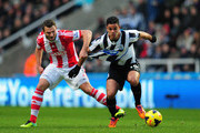 Newcastle player Hatem Ben Arfa  (r) tangles with Erik Peters during the Barclays Premier League match between Newcastle United and Stoke City at St James' Park on December 26, 2013 in Newcastle upon Tyne, England.