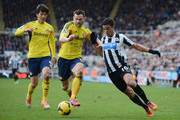 Hatem Ben Arfa of Newcastle is challenged by Phil Bardsley (C) and Ki Sung-Yong (L) of Sunderland during the Barclays Premier League match between Newcastle United and Sunderland at St James' Park on February 1, 2014 in Newcastle upon Tyne, England.