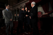 U.S. Sen. Doug Jones (D-AL) (2nd L) kisses his wife Louise (3rd L) as son Christopher (L) and Vice President Mike Pence (R) look on during a mock swearing-in ceremony at the Old Senate Chamber of the U.S. Capitol January 3, 2018 in Washington, DC. Jones is the first Democratic senator from Alabama in more than two decades. He defeated Roy Moore leaving Republicans with a 51-49 majority in the U.S. Senate.