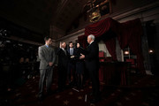 U.S. Sen. Doug Jones (D-AL) (2nd L) participates in a mock swearing-in ceremony with Vice President Mike Pence (R) as JonesÕ wife Louise (4th L), sons Carson (3rd L) and Christopher (L) look on at the Old Senate Chamber of the U.S. Capitol January 3, 2018 in Washington, DC. Jones is the first Democratic senator from Alabama in more than two decades. He defeated Roy Moore leaving Republicans with a 51-49 majority in the U.S. Senate.
