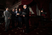 U.S. Sen. Doug Jones (D-AL) (2nd L) shakes hands with Vice President Mike Pence (R) as Jones' wife Louise (4th L), sons Carson (3rd L) and Christopher (L) look on during a mock swearing-in ceremony   at the Old Senate Chamber of the U.S. Capitol January 3, 2018 in Washington, DC. Jones is the first Democratic senator from Alabama in more than two decades. He defeated Roy Moore leaving Republicans with a 51-49 majority in the U.S. Senate.