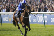 Paul Hanagan riding Taghrooda win The Tweenhills Pretty Polly Stakes at Newmarket racecourse on May 04, 2014 in Newmarket, England.
