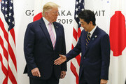 U.S. President Donald J. Trump (L) with Japanese Prime Minister Shinzo Abe (R) at the start of talks at the venue of the G20 Summit on June 28, 2019 in Osaka, Japan. U.S. President Donald Trump arrived in Osaka on Thursday for the annual Group of 20 gathering together with other world leaders who will use the two-day summit to discuss pressing economic, climate change, as well as geopolitical issues. The US-China trade war is expected to dominate the meetings in Osaka as President Trump and China's President Xi Jinping are scheduled to meet on Saturday in an attempt to resolve the ongoing the trade clashes between the world's two largest economies.
