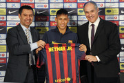 Neymar (C) holds his new jersey with the FC Barcelona Vice-President Josep Maria Bartomeu (L) and FC Barcelona Sport Director Andoni Zubizarreta during the official presentation as a new player of the FC Barcelona at Camp Nou Stadium on June 3, 2013 in Barcelona, Spain.