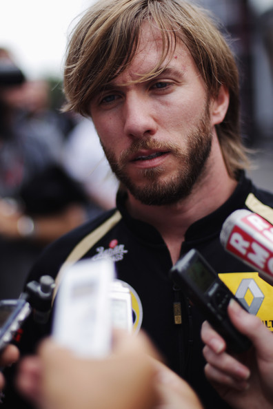 Nick Heidfeld Nick Heidfeld of Germany and Renault is interviewed in the paddock by the media during previews to the Belgian Formula One Grand Prix at the Circuit of Spa Francorchamps on August 25, 2011 in Spa Francorchamps, Belgium.