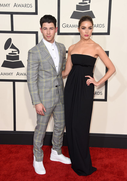 57th GRAMMY Awards - Arrivals [flooring,suit,formal wear,carpet,fashion,red carpet,tuxedo,arrivals,nick jonas,olivia culpo,grammy awards,california,los angeles,staples center,l,the 57th annual grammy awards]