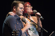 "Comedians Nick Offerman (L) and Megan Mullally perform during the ""Summer of 69: No Apostrophe"" Tour at The Wiltern on May 21, 2015 in Los Angeles, California."