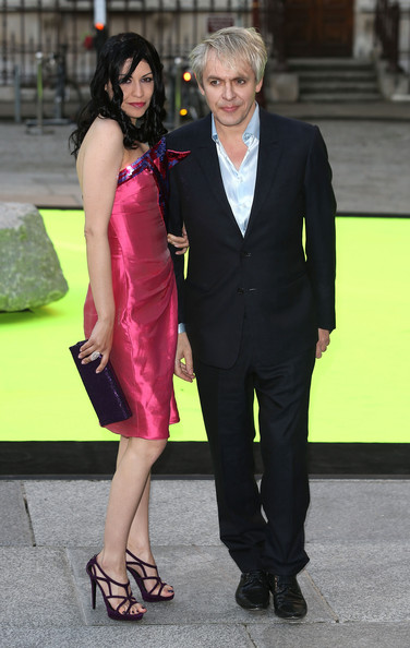 Arrivals at the Royal Academy of Arts Summer Exhibit [clothing,suit,fashion,formal wear,dress,hairstyle,yellow,cocktail dress,footwear,event,arrivals,nick rhodes,nefer suvio,england,london,party,royal academy of arts,preview party,royal academy of arts summer exhibition,the royal academy of arts summer exhibition 2013]