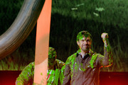 Actors Josh Gad (L) and Jason Sudeikis react after getting slimed onstage during Nickelodeon's 2016 Kids' Choice Awards at The Forum on March 12, 2016 in Inglewood, California.