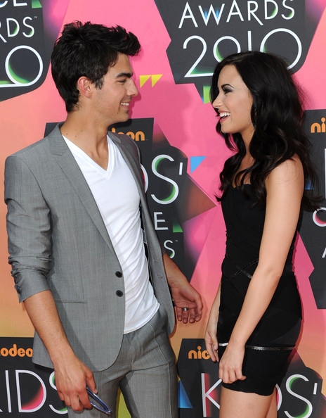 Singer Joe Jonas (L) and actress Demi Lovato arrive at Nickelodeon's 23rd Annual Kid's Choice Awards held at UCLA's Pauley Pavilion on March 27, 2010 in Los Angeles, California.