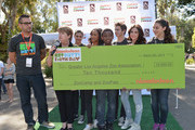 (L-R) DJ J Boogie, President, Greater Los Angeles Zoo Association Connie Morgan, actors Amber Montana, Sydney Park, Curtis Harris, Jack Griffo, Ryan Newman and Kira Kosarin speak at Nickelodeon Get Dirty Earth Day at Los Angeles Zoo on March 9, 2014 in Los Angeles, California.