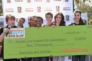 (L-R) President, Greater Los Angeles Zoo Association, Connie Morgan and actors Amber Montana, Sydney Park, Curtis Harris, Jack Griffo, Ryan Newman and Kira Kosarin attend Nickelodeon Get Dirty Earth Day at Los Angeles Zoo on March 9, 2014 in Los Angeles, California.
