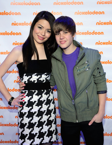 Actress Miranda Cosgrove and musician Justin Bieber attend the Nickelodeon 2010 Upfront Presentation at Hammerstein Ballroom on March 11, 2010 in New York City.