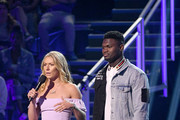 (L-R) Mikaela Shiffrin and  Zion Williamson speak onstage during Nickelodeon Kids' Choice Sports 2019 at Barker Hangar on July 11, 2019 in Santa Monica, California.