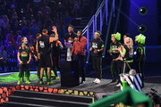 (L-R) Laurie Hernandez, Olivia Moultrie, David Dobrik, Rob Gronkowski, P. K. Subban, host Michael Strahan, Trae Young, Shaun White, Nyjah Huston, Lindsey Vonn, and Kel Mitchell react after a challenge onstage during Nickelodeon Kids' Choice Sports 2019 at Barker Hangar on July 11, 2019 in Santa Monica, California.
