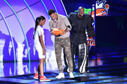 NBA player Stephen Curry (C) accepts the Clutch Player of the Year award from Little League Baseball player Mo'ne Davis (L) and tv personality Nick Cannon (R) onstage at the Nickelodeon Kids' Choice Sports Awards 2015 at UCLA's Pauley Pavilion on July 16, 2015 in Westwood, California.