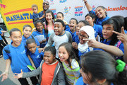 Amani Toomer,  Amani Jr. Toomer, Jasmine Toomer, Amber Montana, Breanna Yde, Benjamin Flores Jr and Curtis Harris Jr attend the NYRoad Runner Club in Times Square host Nickelodeon themed 5 borough relay race on September 20, 2013 in New York City.