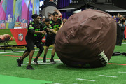 Former NFL player Deion Sanders and NFL players Stefon Diggs and Luke Kuechly attend the Superstar Slime Showdown taping at Nickelodeon at the Super Bowl Experience on February 1, 2018 in Minneapolis, Minnesota.