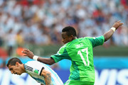 Angel di Maria of Argentina is challenged by Ogenyi Onazi of Nigeria during the 2014 FIFA World Cup Brazil Group F match between Nigeria and Argentina at Estadio Beira-Rio on June 25, 2014 in Porto Alegre, Brazil.