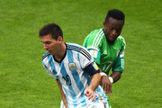 Lionel Messi of Argentina controls the ball against Ogenyi Onazi of Nigeria during the 2014 FIFA World Cup Brazil Group F match between Nigeria and Argentina at Estadio Beira-Rio on June 25, 2014 in Porto Alegre, Brazil.