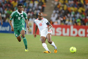 Charles Kabore of Burkina Faso and John Obi Mikel of Nigeria in action during the 2013 Orange African Cup of Nations Final match between Nigeria and Burkina Faso from the National Stadium on February 10, 2013 in Johannesburg, South Africa.