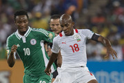 John Obi Mikel of Nigeria (L) and Charles Kabore (Captain) of Burkina Faso (R) in action during the 2013 Orange African Cup of Nations Final match between Nigeria and Burkina Faso from the National Stadium on February 10, 2013 in Johannesburg, South Africa.