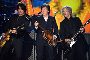 (L-R) Musicians Rusty Anderson, Paul McCartney and Brian Ray perform onstage during 'The Night That Changed America: A GRAMMY Salute To The Beatles' at the Los Angeles Convention Center on January 27, 2014 in Los Angeles, California.