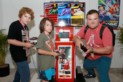 (L-R) Samuel Black, Thomas Black and Jack Black visit the Nintendo booth during the 2018 E3 Gaming Convention at Los Angeles Convention Center on June 12, 2018 in Los Angeles, California.