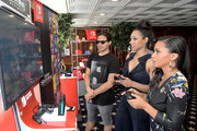 Carlos Valdes, Candice Patton and Danielle Nicolet test their skills on Super Smash Bros. Ultimate for Nintendo Switch at the Variety Studio at Comic-Con 2018 on July 21, 2018 in San Diego, California.