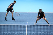 Jamie Murray of Great Britain and Bruno Soares of Brazil return the ball in their doubles semi finals match against Mike Bryan and Jack Sock of The United States during Day Seven of the Nitto ATP Finals at The O2 Arena on November 17, 2018 in London, England.