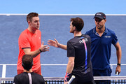 Mike Bryan and Jack Sock of The United States shakes hands with Jamie Murray of Great Britain and Bruno Soares of Brazil after their double semi finals match during Day Seven of the Nitto ATP Finals at The O2 Arena on November 17, 2018 in London, England.