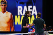 Rafael Nadal of Spain interacts with Stefanos Tsitsipas of Greece after his victory in their third round robin match on Day Five of the Nitto ATP World Tour Finals at The O2 Arena on November 19, 2020 in London, England.
