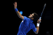 Novak Djokovic of Serbia serves during his singles semi final match against Dominic Thiem of Austria during day seven of the Nitto ATP World Tour Finals at The O2 Arena on November 21, 2020 in London, England.