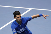 Novak Djokovic of Serbia plays a forehand volley during his singles semi final match against Dominic Thiem of Austria during day seven of the Nitto ATP World Tour Finals at The O2 Arena on November 21, 2020 in London, England.
