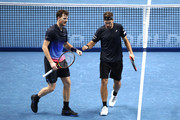 Jamie Murray of Great Britain and Brunro Soares of Brazil celebrate during doubles round robin match against Juan Sebastian Cabal of Columbia and Robert Farah of Columbia during Day Three of the Nitto ATP Finals at The O2 Arena on November 13, 2018 in London, England.