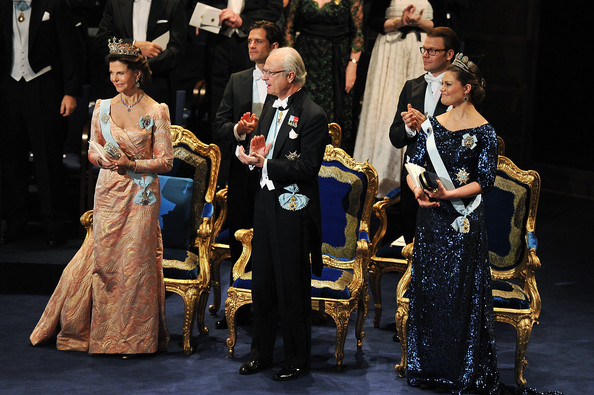 (Second row) Prince Carl Philip of Sweden (L) and Prince Daniel of Sweden (R) and (front row) Queen Silvia of Sweden (L), Crown Princess Victoria of Sweden (C) and King Carl XVI Gustaf of Sweden (R) applaud the Nobel Prize Award Ceremony at Stockholm Concert Hall on December 10, 2011 in Stockholm, Sweden.