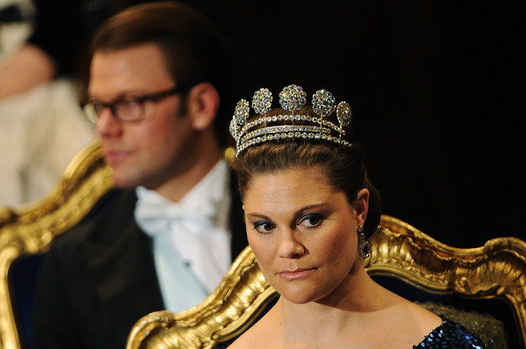 Prince Daniel of Sweden (background) and Crown Princess Victoria of Sweden attend the Nobel Prize Award Ceremony at Stockholm Concert Hall on December 10, 2011 in Stockholm, Sweden.