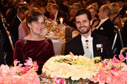 Dr Vickers Burdett and Prince Carl Philip of Sweden attend the Nobel Prize Banquet 2015 at City Hall on December 10, 2015 in Stockholm, Sweden.