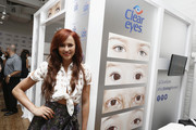 Danielle Moinet poses for a photo at the Clear Eyes photo booth at the Nolcha Shows during New York Fashion Week Spring/Summer 2019 on September 6, 2018 in New York City.