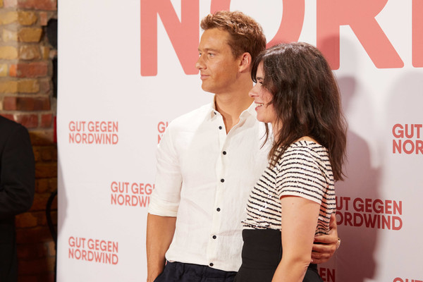 'Gut Gegen Nordwind' Family And Friends Preview In Berlin [red,yellow,fashion,premiere,event,font,flooring,style,carpet,alexander fehling,nora tschirner,gut gegen nordwind,family friends preview,germany,l-r,family friends preview at kulturbrauerei,berlin]