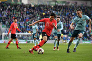 Jonny Evans of Northern Ireland and Changhoon Kwon of South Korea during the international friendly match between Northern Ireland and South Korea at Windsor Park on March 24, 2018 in Belfast, Northern Ireland.