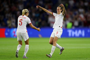 Steph Houghton and Jill Scott of England celebrate following their sides victory in the 2019 FIFA Women's World Cup France Quarter Final match between Norway and England at Stade Oceane on June 27, 2019 in Le Havre, France.