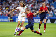 Jill Scott of England is challenged by Kristine Minde of Norway during the 2019 FIFA Women's World Cup France Quarter Final match between Norway and England at Stade Oceane on June 27, 2019 in Le Havre, France.