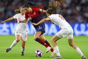 Ingrid Syrstad Engen of Norway is challenged by Fran Kirby of England and Jill Scott of England during the 2019 FIFA Women's World Cup France Quarter Final match between Norway and England at Stade Oceane on June 27, 2019 in Le Havre, France.