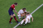 Jill Scott of England checks on teammate Ellen White who goes down injured during the 2019 FIFA Women's World Cup France Quarter Final match between Norway and England at Stade Oceane on June 27, 2019 in Le Havre, France.