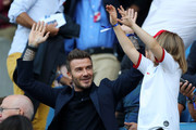 David Beckham is seen in the stands doing a mexican wave with his daughter, Harper, prior to the 2019 FIFA Women's World Cup France Quarter Final match between Norway and England at Stade Oceane on June 27, 2019 in Le Havre, France.